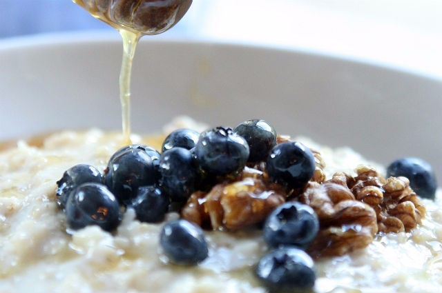 An image of Energising Porridge With Blueberries, Toasted Walnuts And Honey Recipe