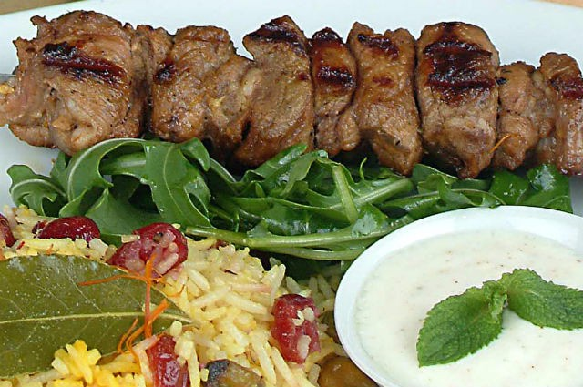 An image of Low Fat Lamb Kebabs On A Bed Of Saffron Rice With Dried Cranberries Recipe