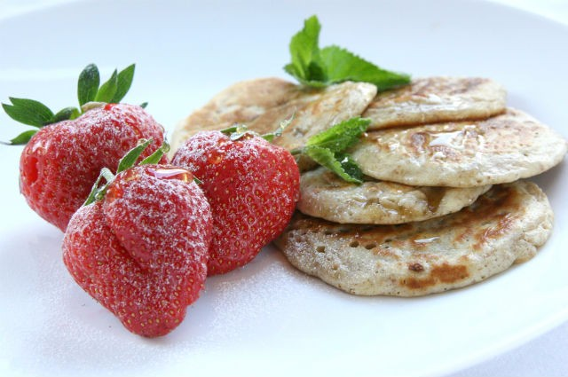 An image of Healthy Hot Oatcakes With Strawberries And Minted Maple Syrup Recipe