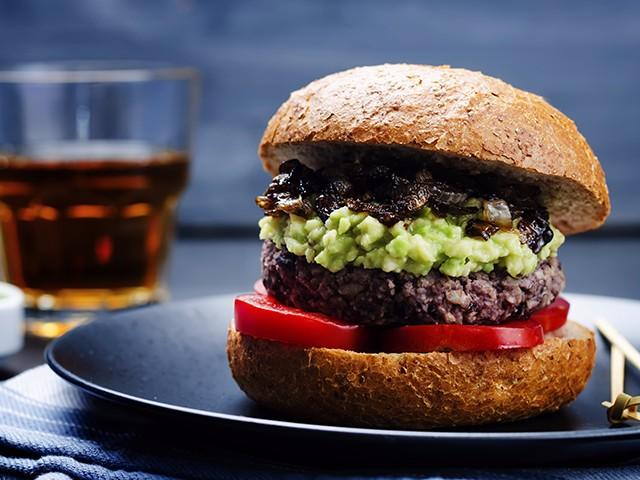 Black bean and sweet potato burgers with avocado mash