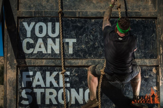 A mudder tackles an obstacle.